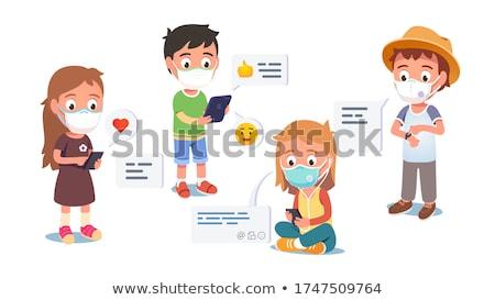Fiúk küldés üzenet mobiltelefon család sport Stock fotó © IS2