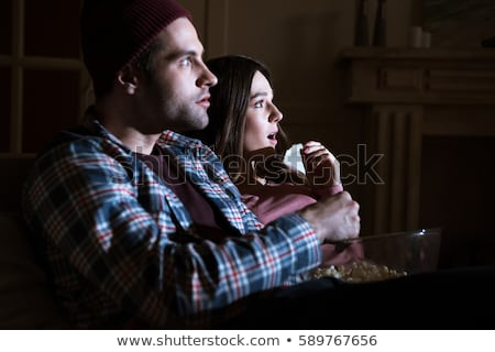 side view of shocked couple watching movie together at home stock photo © lightfieldstudios