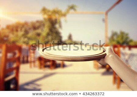hand with glove holds tray with glass of champagne stock photo © denismart