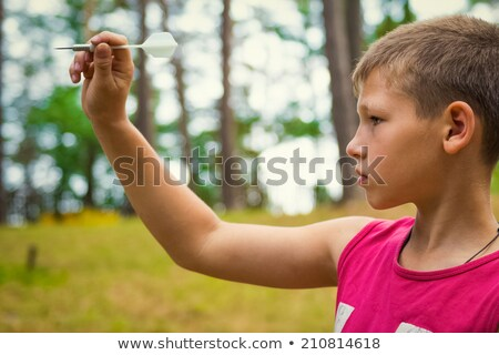 Boy taking aim with dart Stock photo © IS2