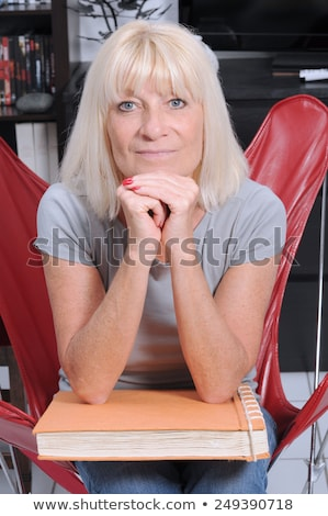 Stock photo: Senior woman with his phto album life
