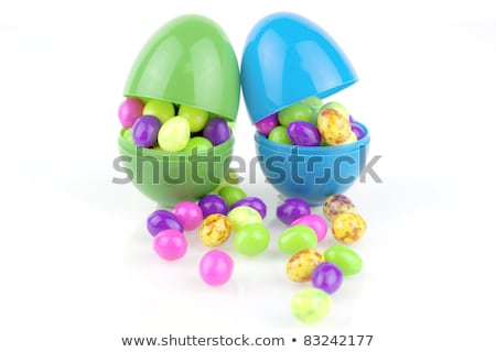 Plastic egg and jellybeans Stock photo © IS2