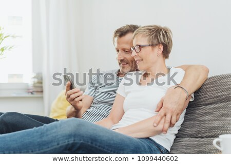Stock photo: Mature Man Looking At Womans Mobile