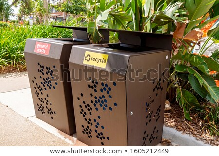 Green recycling bin by hedge Stock photo © IS2