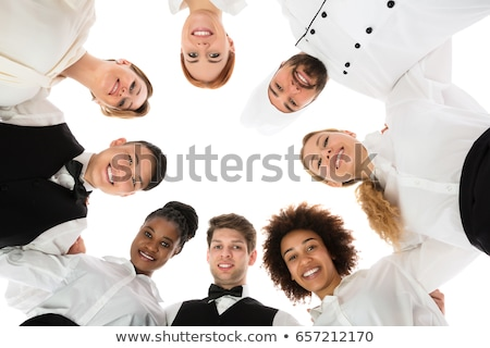 Young Hotel Staff Forming Huddle Stock photo © AndreyPopov