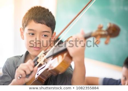 school boy Black_classic music Stock photo © toyotoyo