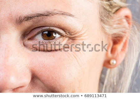 Wrinkled eye of beautiful lady Stock photo © boggy