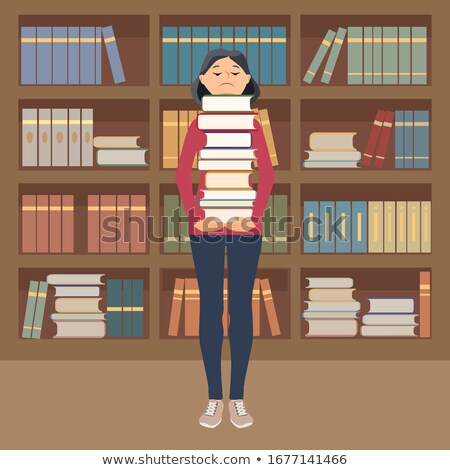 Beautiful young girl stands in the office and holds a stack of books in her hands. Stock photo © Traimak