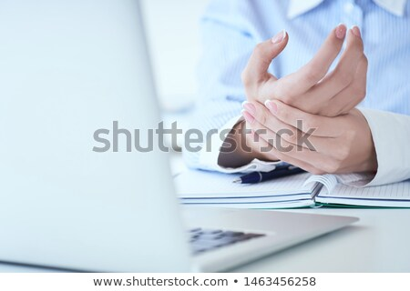 close up of a businesswomans hand holding her painful wrist stock photo © andreypopov