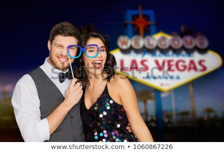 couple with party glasses having fun at las vegas stock photo © dolgachov