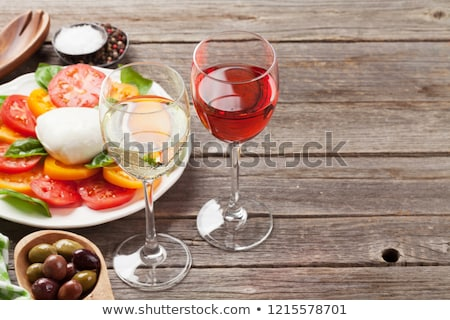Stock photo: Caprese salad with rose and white wine