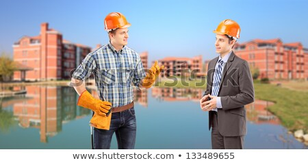 Portrait Of Happy Construction Site Supervisor Talking To Manual Worker Stock photo © diego_cervo