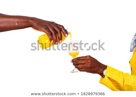 Man looking at woman pouring juice in glass Stock photo © Kzenon