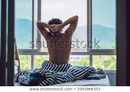fiatalember · felfelé · hálószoba · fiatal · boldog · mosolyog - stock fotó © galitskaya