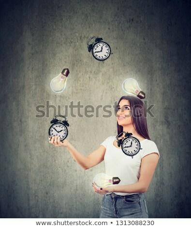 Gelukkig jonge vrouw jongleren heldere alarm klokken Stockfoto © ichiosea