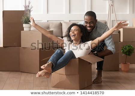 Two women having rented a new apartment moving in  Stock photo © Kzenon