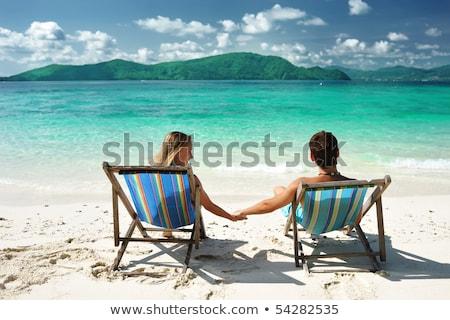 jovem · alegre · casal · relaxante · praia · tropical · praia - foto stock © majdansky