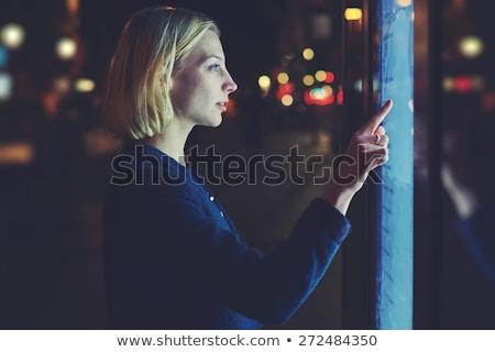 Person touching light blue hologram screen Stock photo © ra2studio
