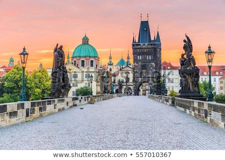 Stock fotó: Híd · Prága · hajnal · Csehország · égbolt · ház