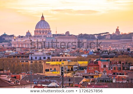Eternal city of Rome rooftops and towers golden sunset view Stock photo © xbrchx