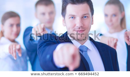Businessman Pointing Finger At Businesswoman Stock photo © AndreyPopov