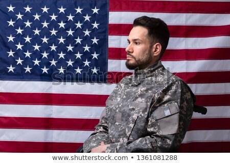 Veterán ül tolószék amerikai zászló oldalnézet férfi Stock fotó © AndreyPopov