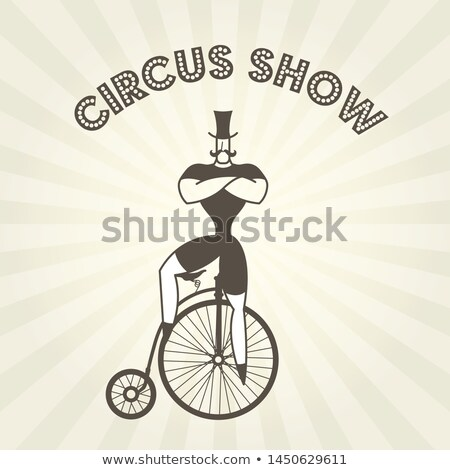 Circus actor on retro bicycle - strongman on old penny farthing  Stock photo © Winner