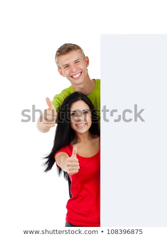 happy couple with red sale sign showing thumbs up Stock photo © dolgachov