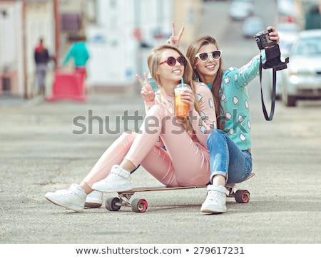mooie · glimlachend · vrouw · mobiele · telefoon · straat - stockfoto © dolgachov
