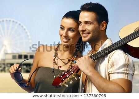 Stock photo: Goodlooking man with guitar smiling