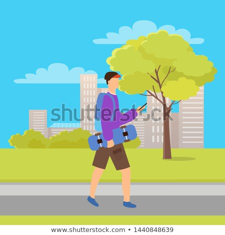 skater going with phone and skateboard in park stock photo © robuart
