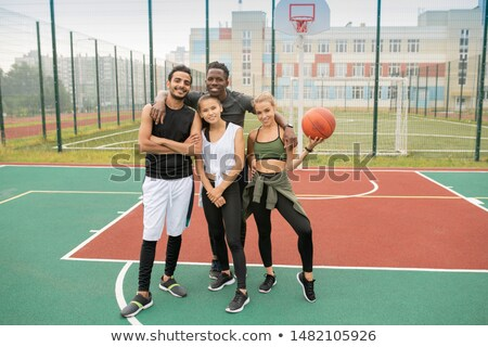Group of young professional intercultural basketball players in sportswear Stock photo © pressmaster