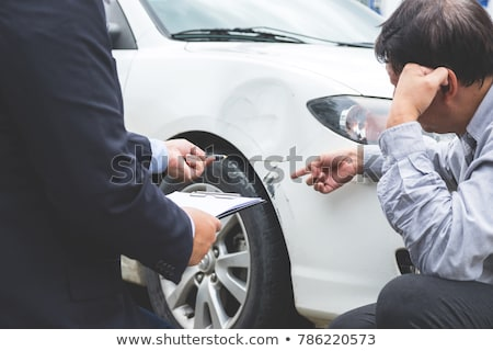Man agent Filling Insurance Form Near Damaged and examining Car, Stock photo © Freedomz