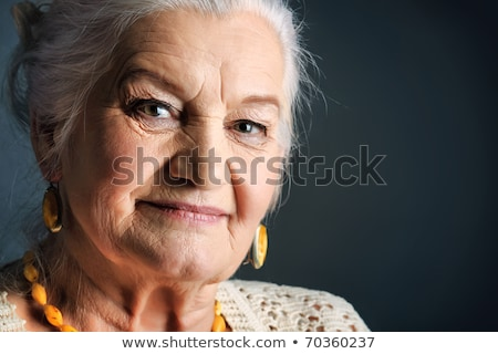 portrait of senior woman over natural background Stock photo © dolgachov