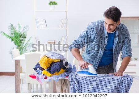 Jonge knappe man huishoudelijk werk huis gelukkig werk Stockfoto © Elnur