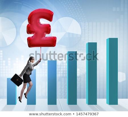 Kobieta interesu pływające brytyjski funt podpisania nadmuchiwane Zdjęcia stock © Elnur