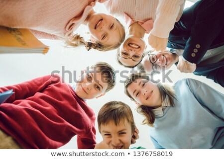 iskolás · fiú · tanul · osztályterem · tanár · boldog · gyermek - stock fotó © kzenon