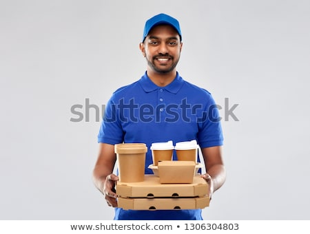 Stock photo: happy indian delivery man with food and drinks
