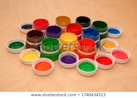 Group of paintbrushes and palettes on background of gouache jars Stock photo © pressmaster