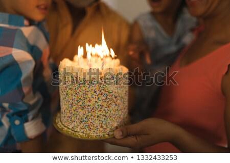 Középső rész afroamerikai család ünnepel születésnap otthon Stock fotó © wavebreak_media