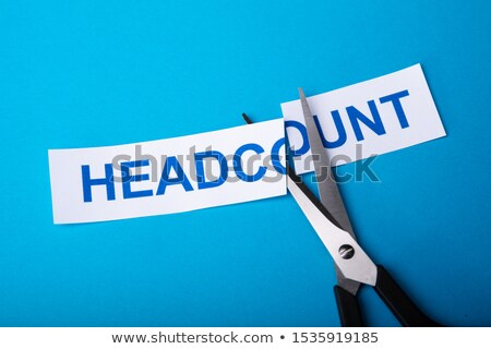 Person Cutting Headcount Using Scissors Stock photo © AndreyPopov