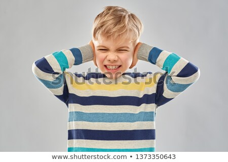 stressed boy in pullover closing ears by hands Stock photo © dolgachov