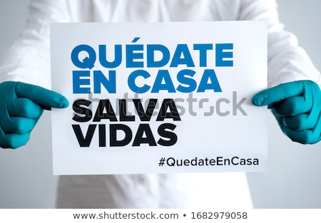 man showing the message i stay at home in spanish stock photo © nito