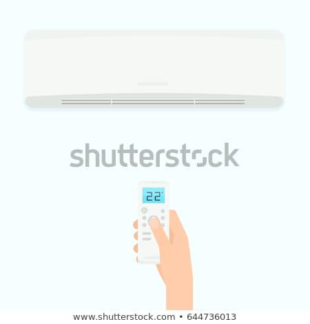 Férfi légkondicionáló távirányító portré távoli iroda Stock fotó © AndreyPopov