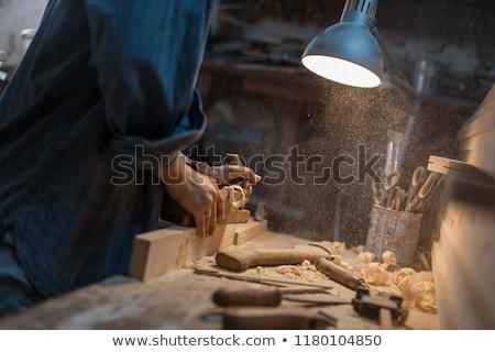 hand of woman carpenter with wood planer Stock photo © Kzenon