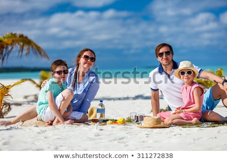 Family having picnic on beach Stock photo © dashapetrenko
