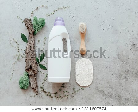 Composition with bottle of laundry detergent by tree bark, tiny  Stock photo © dashapetrenko