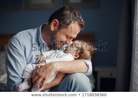 Orta yaşlı baba bebek kız ev aile Stok fotoğraf © dolgachov