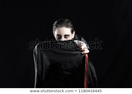 Portrait of a beautiful young woman all dressed up. Stock photo © HASLOO