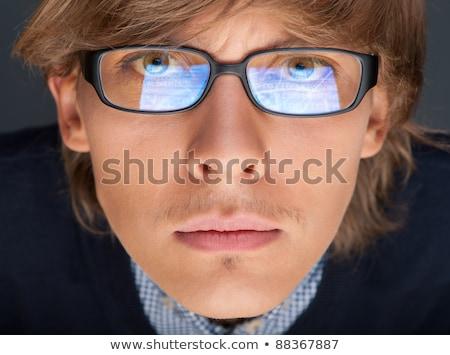 満足した 若い男 眼鏡 見える カメラ のような ストックフォト © HASLOO